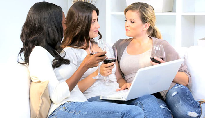 Polished Mobile Nails - three women having a conversation with a glass of wine