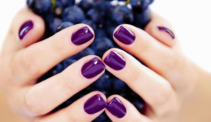 Polished Mobile Nails - purple nails holding grapes