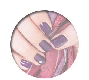 Polished Mobile Nails - female hand holding scarf with purple nails